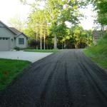 Gravel Paved Driveway in Rockford.  Customer was concerned about the border between the driveway and the lawn.  Once complete, they were very happy with the clean straight lines we were able to create.