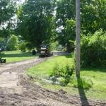 BEFORE picture of Mike's gravel driveway in Cedar Springs, had drainage issues and clay base.  Ready for the Gravel Paving with Crushed Asphalt.