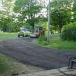 AFTER - Final grade complete, rolling the crushed asphalt with our vibrating roller.  This creates a perfectly flat driving surface.  Mike's new gravel paved crushed asphalt driveway complete!