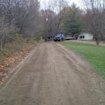 Photo of Lori's driveway, long slope repaired with crushed concrete. www.gravelgraders.com