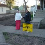 Steven and his wife Penny in front of their new crushed asphalt/crushed blacktop driveway!  www.gravelgraders.com