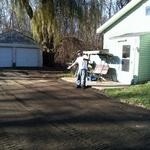 Andy pointing out his new crushed asphalt/crushed blacktop driveway.  Congratulations Andy and Melanie, enjoy your new driveway, it was a pleasure working with you!  www.gravelgraders.com